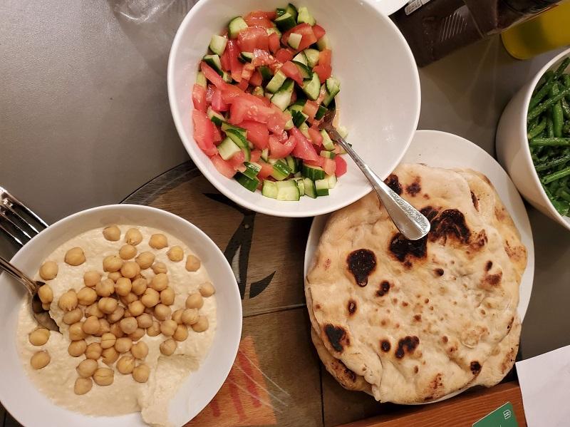 Home made pita, hummus and salad